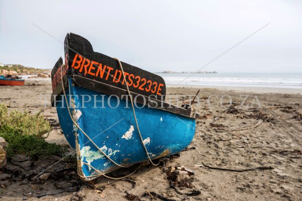 Blue and Orange Fishing Boat on the beach