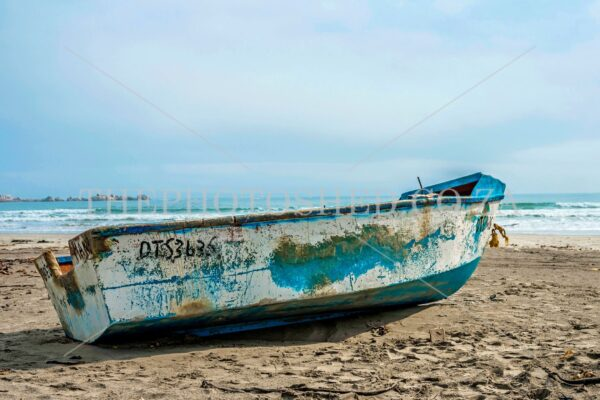 white fishing boat on the beach