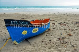 Blue fishing boat on the beach