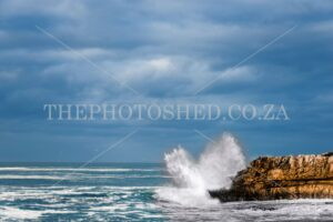 Wave slamming rock at Hermanus new harbour