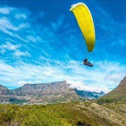 the photo shed,photographs of africa,photographs of south africa,south africa,photography,south african aerials,cape town,hand glider,yellow,blue skies,mountain,flying,fynbos